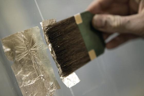 laying 12 karat white gold leaf