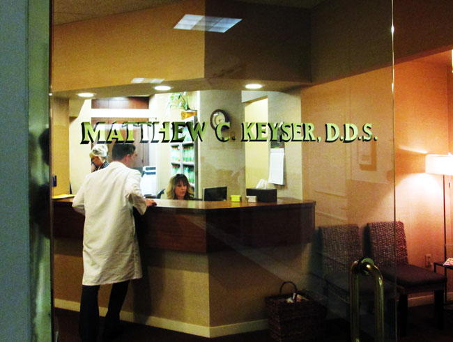 Gold Leaf Doctors Office Sign on Glass